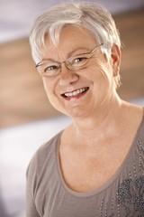 Portrait of happy female pensioner