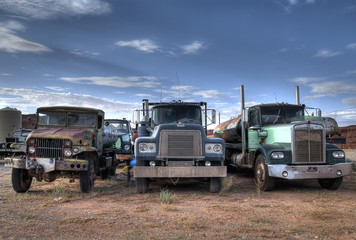 Foto op Aluminium Oude auto s Three trucks on Junkyard