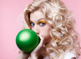 blonde girl with balloon