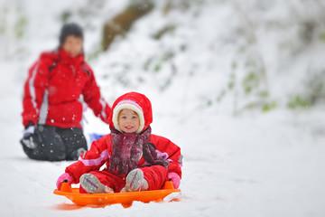 girl on sleigh