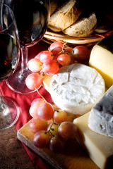 Red dry wine and cheese, still life