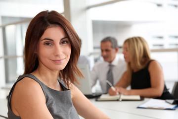 Portrait of beautiful businesswoman in work meeting
