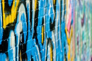Abstract graffiti closeup on the textured brick wall