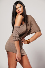 Girl with long black hair in gray dress.