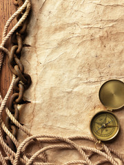 Compass, rope, paper and chain
