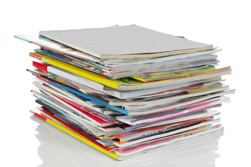 shot of stack of magazines isolated over white