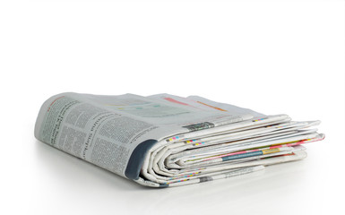 stack of news paper over white background