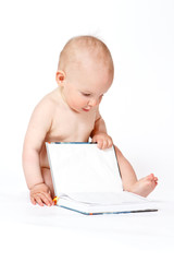 Small baby boy with book