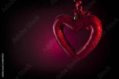Cuore Bucato Su Sfondo Nero Con Luce Rossa Stock Photo And Royalty