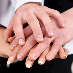 Close-up handshake between many business persons