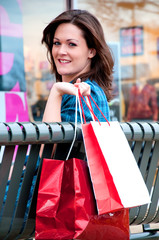 Young Brunette Female Shopper Resting