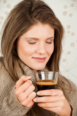 Beauty, young girl holding a cup of coffee