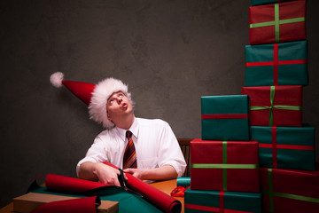 Funny business guy packing christmas gifts