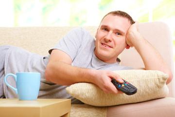 Smiling man watching television