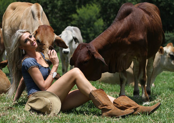 Beautiful lady with the cows