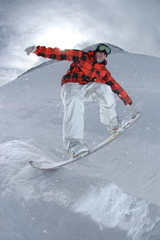 Jumping freestyle snowboarder