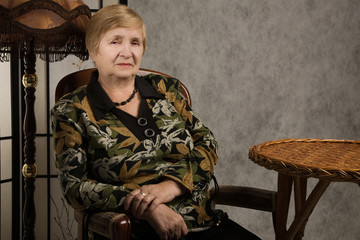 Old woman in a vintage style interior