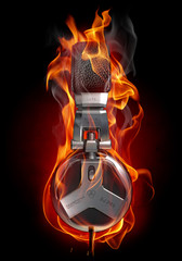 Poster de jardin Flamme Headphones in fire