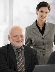 Portrait of senior businessman with partner