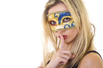 masked woman making silence gesture