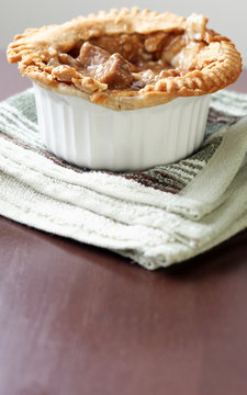 Vertical image of beef pot pie with extra copyspace