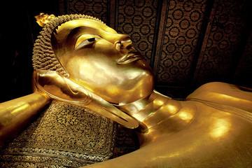 The gold Reclining Buddha in Wat Pho, Bangkok Thailand