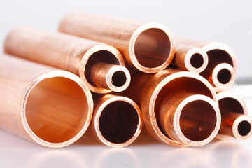 Set of copper pipes of different diameter