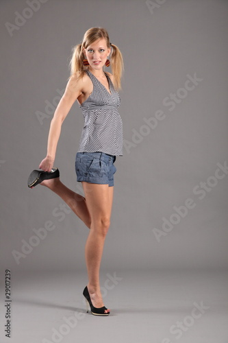 "Sexy blonde fashion model in heels and shorts"" Stock photo and ..."