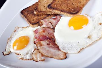 Breakfast - toasts, eggs, bacon