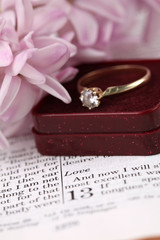 Engagement ring on the Bible open to 1st Corinthians 13