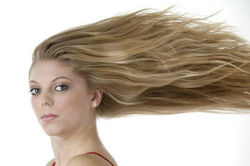 Stunning teenage girl with extreme blowing blonde hair