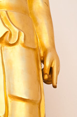 Hand of golden buddha point to earth