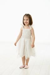 Smiling little girl in ballet costume