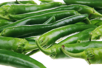 pile of spicy green hot chili peppers