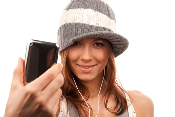 Pretty young girl showing cellular mobile phone