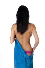 beautiful girl in a blue towel from the back
