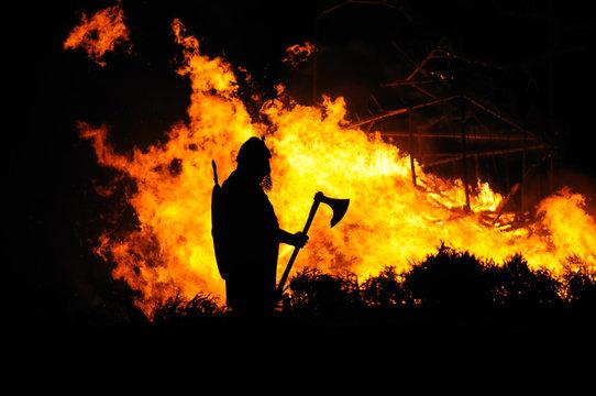 Viking and burning building