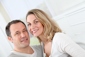 Portrait of happy couple at home