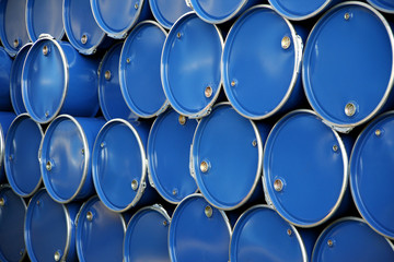 blue barrels in the warehouse of a company
