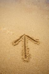 Arrow in beach sand