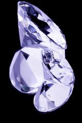 two gemstones on mirror