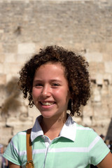 Portrait of smiling girl near Western Wall (Israel)