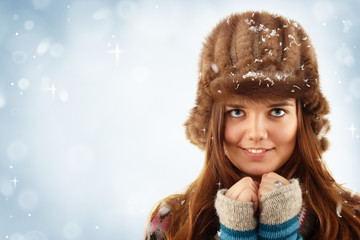 teennager girl pretty smiling on winter blue background