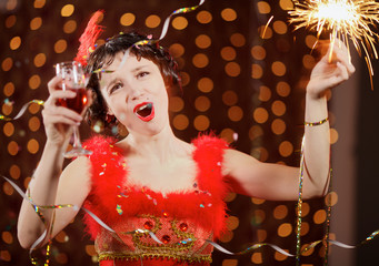 Lady in red dress at the carnival with champagne flute