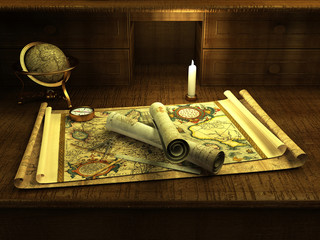 Vintage globe and compass on antique map
