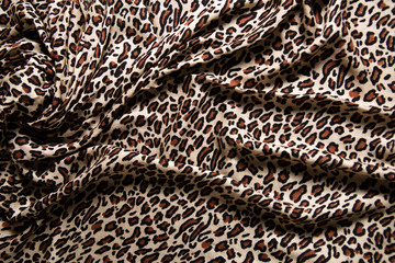 Close-up of a folds of stylish leopard scarf.