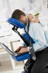 Businessman getting neck massage