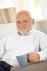 Portrait of senior with coffee mug