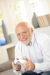 Senior man enjoying computer game