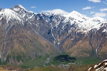 Caucasus Mountains and Stepantsminda village. Georgia.